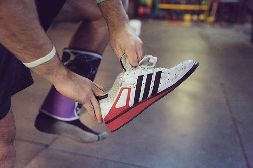 Holding Weightlifting Shoes